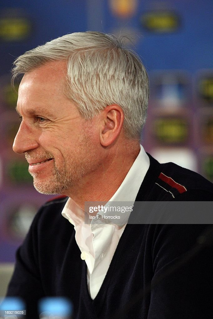 Manager Alan Pardew of Newcastle United smiles during a press conference, ahead of their UEFA Europa League round of 16 first leg match against Anzhi Makhachkalaat, at the Luzhniki Stadium on March 6, 2013 in Moscow, Russia.
