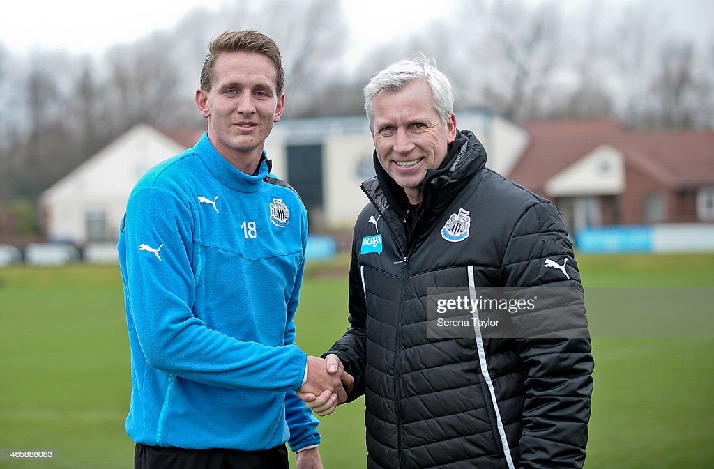 Manager <a gi-track='captionPersonalityLinkClicked' href=/galleries/search?phrase=Alan+Pardew&family=editorial&specificpeople=171147 ng-click='$event.stopPropagation()'>Alan Pardew</a> shakes hands with New Signing Luuk de Jong after a training session at The Newcastle United Training Centre on January 30, 2014, in Newcastle upon Tyne, England.