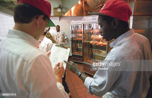A manager and an employee at Boston Chicken discuss how many chickens should be roasted