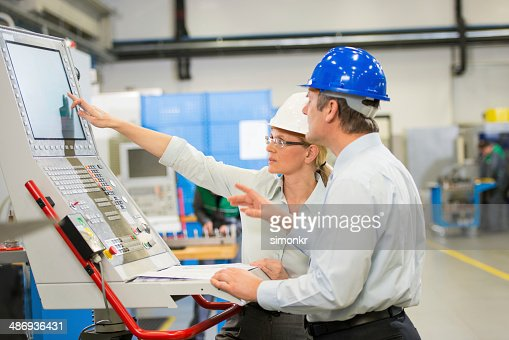 Manager And Engineer Programming A CNC