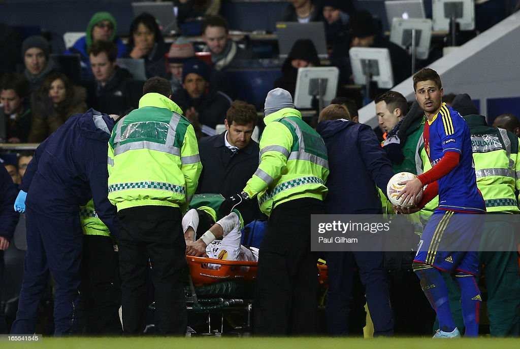 Manager Andre Villa Boas of Tottenham Hotspur looks at Gareth Bale of Tottenham Hotspur as he is stretchered off injured during the UEFA Europa League quarter-final first leg between Tottenham Hotspur FC and FC Basel 1893 at White Hart Lane on April 4, 2013 in London, England.