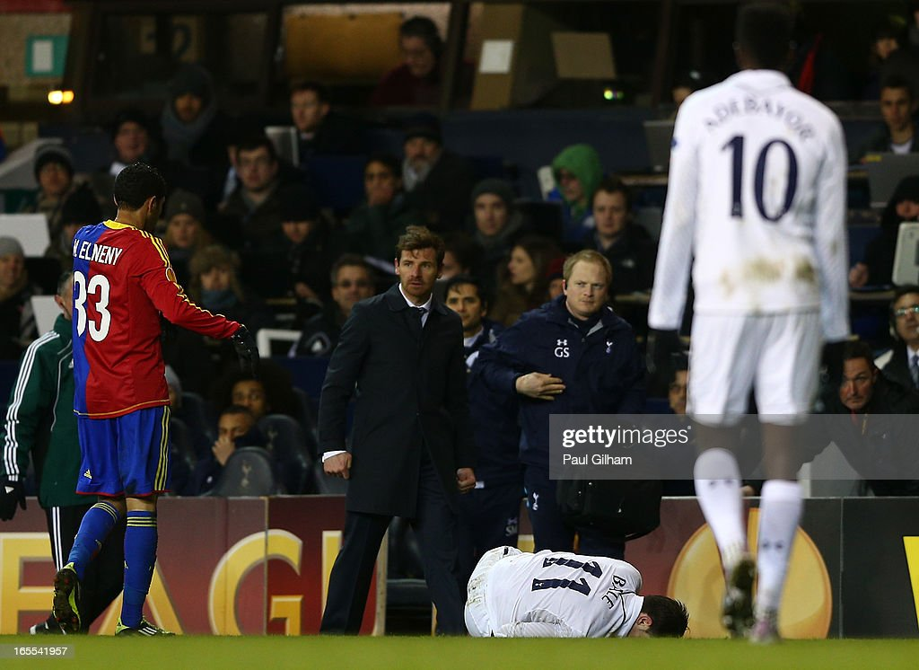 Manager Andre Villa Boas of Tottenham Hotspur looks to Mohamed Elneny of FC Basel as Gareth Bale of Tottenham Hotspur lies injured during the UEFA Europa League quarter-final first leg between Tottenham Hotspur FC and FC Basel 1893 at White Hart Lane on April 4, 2013 in London, England.