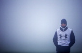 Manager Andre VillasBoas keeps an eye on the session in the fog during Tottenham Hotspur training session ahead of their UEFA Europa League group...