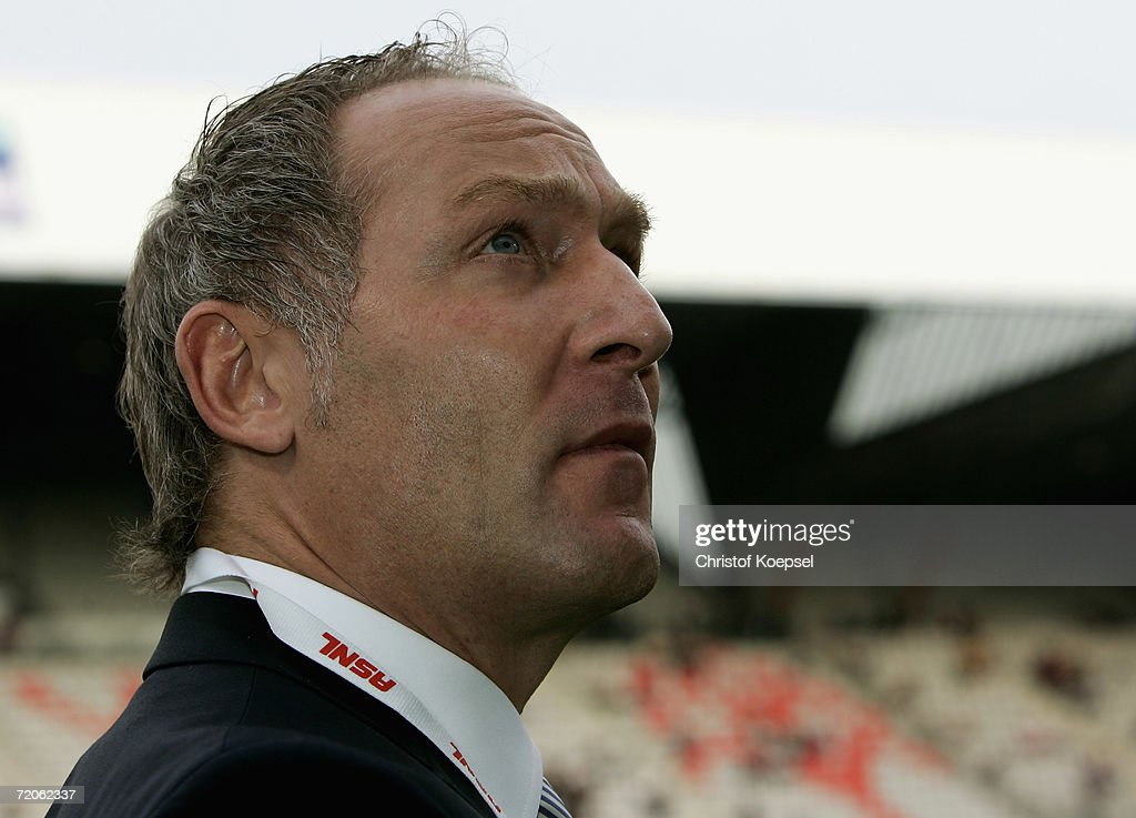 Manager Andreas Mueller of Schalke is thoughtful during the UEFA Cup second leg match between AS Nancy and Schalke 04 at the Marcel Picot Stadium on...