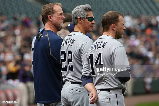 Manager Andy Green hitting coach Alan Zinter and Mark McGwire of the San Diego Padres observe the national anthem prior to facing the Colorado...