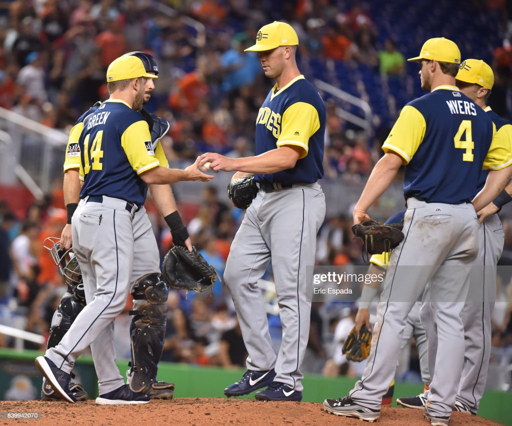 Manager Andy Green #14 of the San Diego Padres takes starting pitcher Clayton Richard #3 out of the game in the eighth inning against the Miami Marlins at Marlins Park on August 27, 2017 in Miami, Florida.