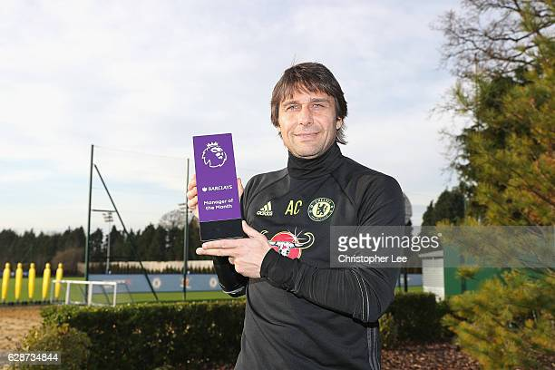 Manager Antonio Conte of Chelsea poses with his Manager of the Month award as Chelsea receive the Monthly Premier League Awards at Chelsea Training...