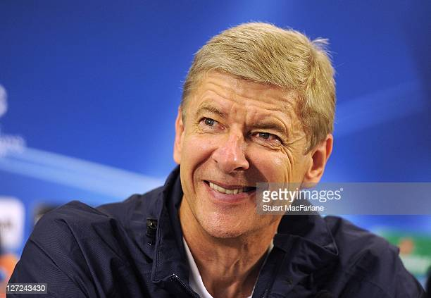 Manager Arsene Wenger attends a press conference ahead of their UEFA Champions League Group stage match against Olympiacos FC at London Colney on...