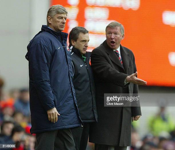 Manager Arsene Wenger of Arsenal argues with manager Sir Alex Ferguson of Manchester United during the FA Barclaycard Premiership match between...