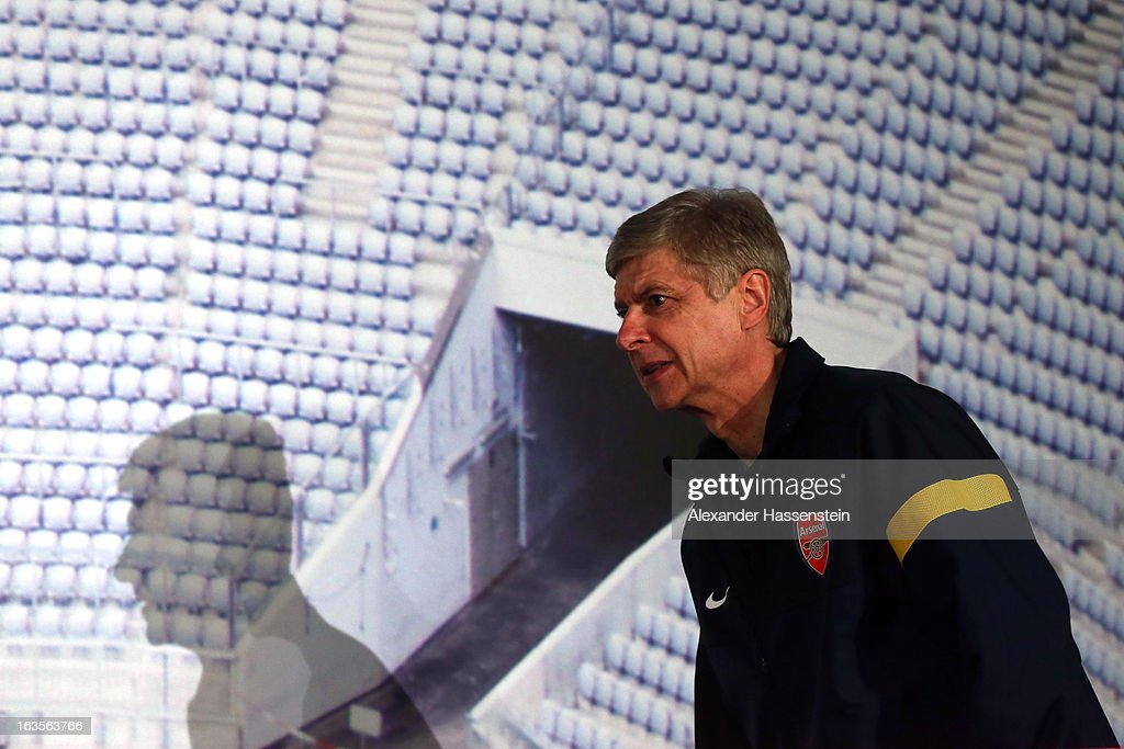 Manager <a gi-track='captionPersonalityLinkClicked' href=/galleries/search?phrase=Arsene+Wenger&family=editorial&specificpeople=171184 ng-click='$event.stopPropagation()'>Arsene Wenger</a> of Arsenal arrives for a Arsenal FC press conference ahead of their UEFA Champions League round of 16 match against Bayern Muenchen at Allianz Arena on March 12, 2013 in Munich, Germany.