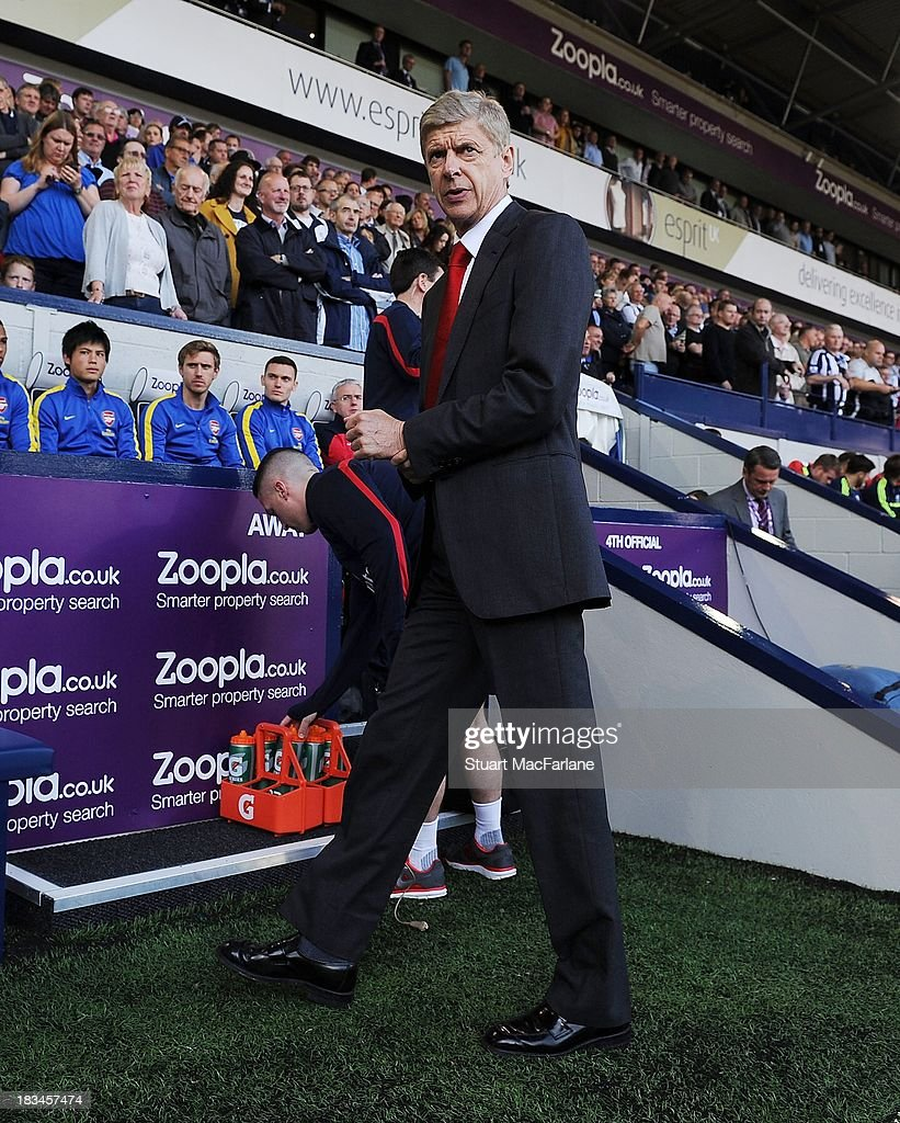 Manager <a gi-track='captionPersonalityLinkClicked' href=/galleries/search?phrase=Arsene+Wenger&family=editorial&specificpeople=171184 ng-click='$event.stopPropagation()'>Arsene Wenger</a> of Arsenal FC looks on before the Barclays Premier League match between West Bromwich Albion and Arsenal FC at The Hawthorns on October 6, 2013 in West Bromwich, England.