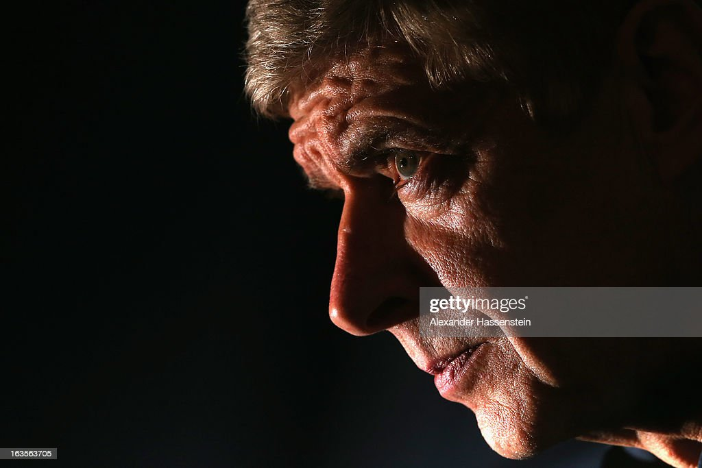 Manager <a gi-track='captionPersonalityLinkClicked' href=/galleries/search?phrase=Arsene+Wenger&family=editorial&specificpeople=171184 ng-click='$event.stopPropagation()'>Arsene Wenger</a> of Arsenal looks on during a Arsenal FC press conference ahead of their UEFA Champions League round of 16 match against Bayern Muenchen at Allianz Arena on March 12, 2013 in Munich, Germany.