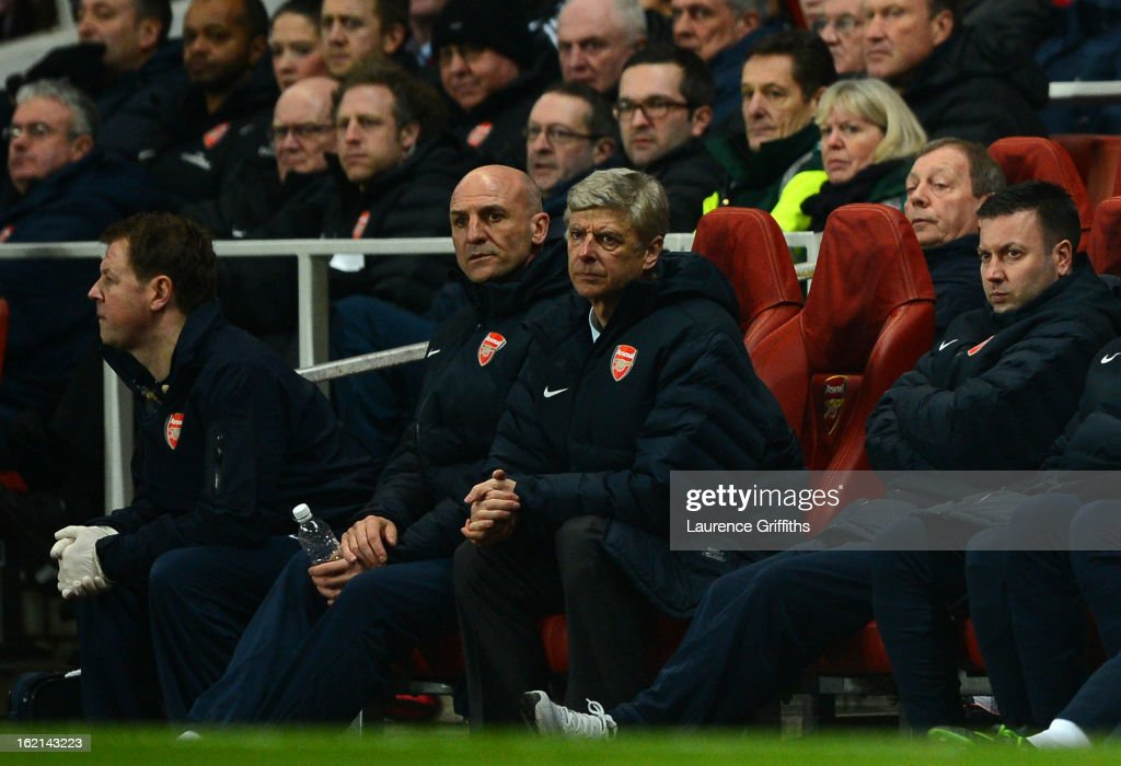 Manager Arsene Wenger of Arsenal looks on from the bench next to his assistant Steve Bould during the UEFA Champions League round of 16 first leg match between Arsenal and Bayern Muenchen at Emirates Stadium on February 19, 2013 in London, England.