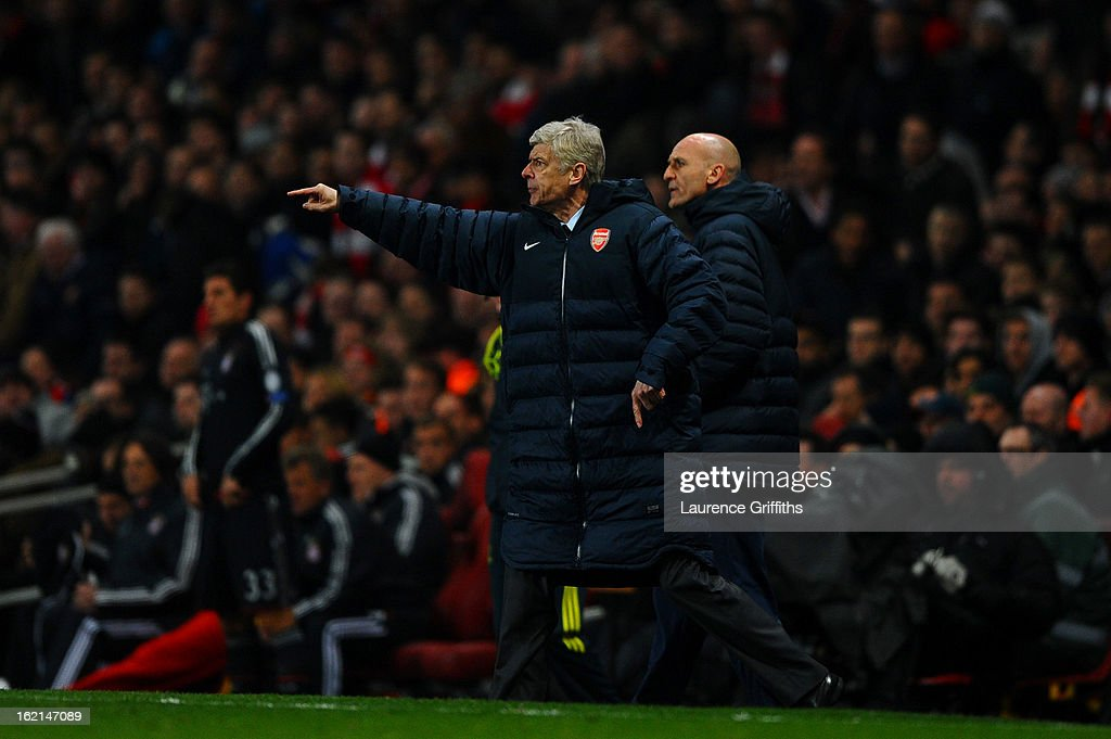 Manager Arsene Wenger of Arsenal reacts next to his assistant Steve Bould during the UEFA Champions League round of 16 first leg match between Arsenal and Bayern Muenchen at Emirates Stadium on February 19, 2013 in London, England.