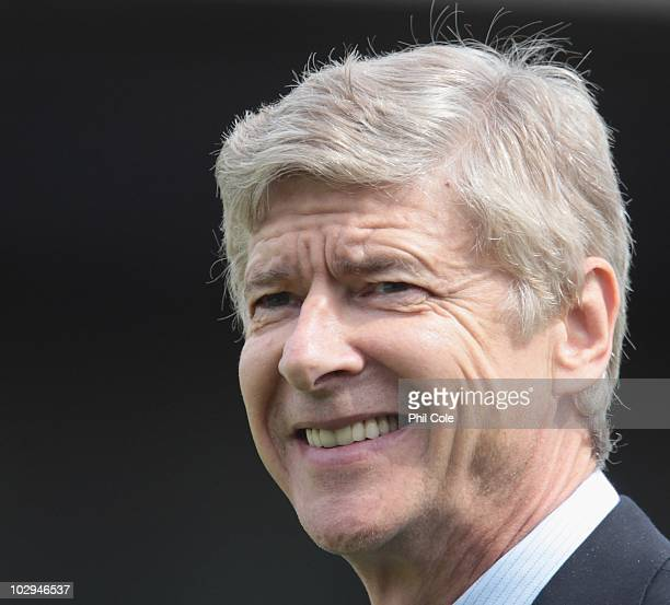 Manager Arsene Wenger of Arsenal smiles during the preseason friendly match between Barnet and Arsenal at Underhill on July 17 2010 in London England