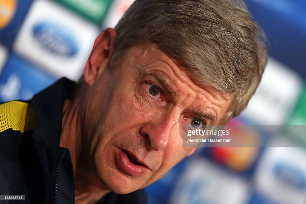 Manager <a gi-track='captionPersonalityLinkClicked' href=/galleries/search?phrase=Arsene+Wenger&family=editorial&specificpeople=171184 ng-click='$event.stopPropagation()'>Arsene Wenger</a> of Arsenal talks to the meadia during a Arsenal FC press conference ahead of their UEFA Champions League round of 16 match against Bayern Muenchen at Allianz Arena on March 12, 2013 in Munich, Germany.