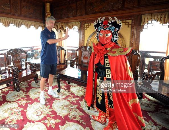 Manager Arsene Wenger of Arsenal with dancer Bian Lian at West Lake during their preseason Asia Tour on July 15 2011 in Hangzhou China