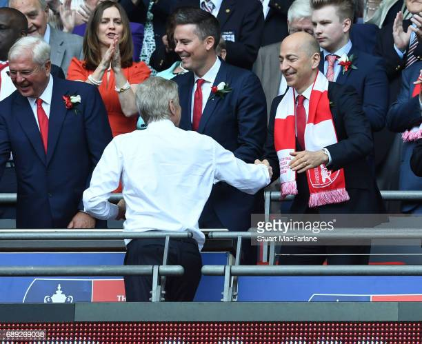 Manager Arsene Wenger shakes hands with Arsenal CEO Ivan Gazidis after the Emirates FA Cup Final between Arsenal and Chelsea at Wembley Stadium on...