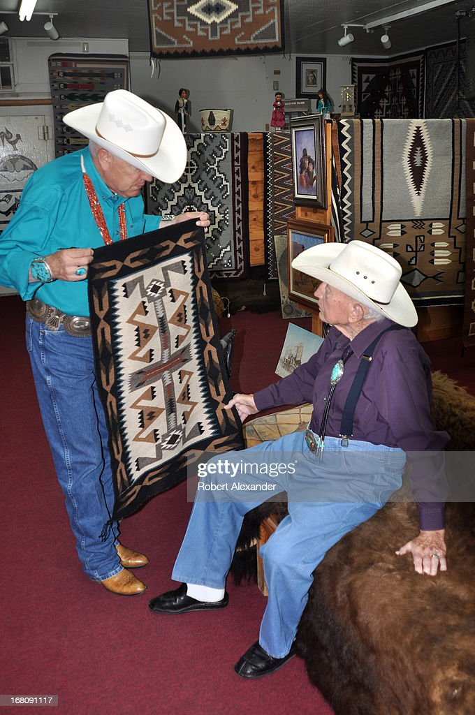 A manager at Richardson's Trading Company & Cash Pawn shows a Navajo rug to the shop's owner, <a gi-track='captionPersonalityLinkClicked' href=/galleries/search?phrase=Bill+Richardson&family=editorial&specificpeople=213321 ng-click='$event.stopPropagation()'>Bill Richardson</a> (seated). The Gallup, New Mexico, landmark on historic Route 66 has served area Native-Americans and catered to tourists and collectors of Navajo rugs, jewelry and other Indian arts since 1913. (Photo by Robert Alexander/Archive Photos/Getty Images) 5104602RA_Gallup47.jpg