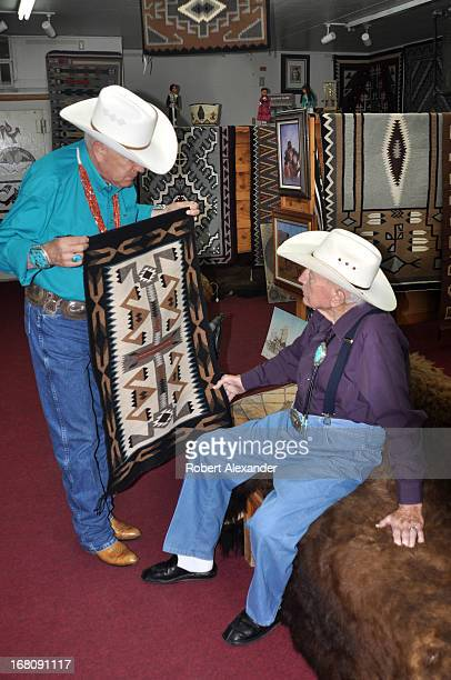 A manager at Richardson's Trading Company Cash Pawn shows a Navajo rug to the shop's owner Bill Richardson The Gallup New Mexico landmark on historic...