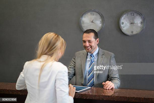 Manager at the front desk with a customer
