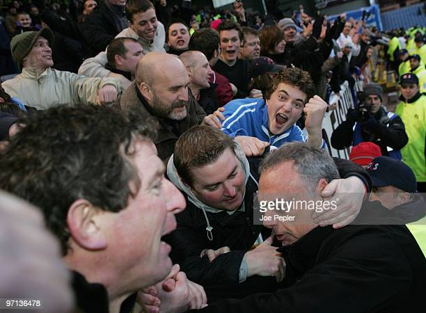 Manager Avram Grant of Portsmouth celebrates their win with fans after the Barclays Premier League match between Burnley and Portsmouth at Turf Moor...