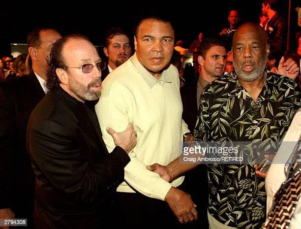 Manager Bernie Yuman escorts Boxer Muhammad Ali and Photographer Howard L Bingham during Art Basel Taschen book premiere of Muhammad Ali's book GOAT...