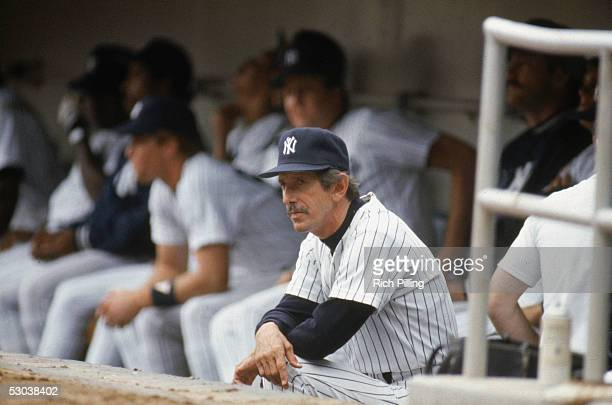 Manager Billy Martin of the New York Yankees sits in the dugout during a game circa 19761977