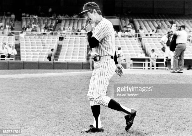 Manager Billy Martin of the New York Yankees walks back to the dugout after protesting the 9th inning of the 'Pine Tar' game against the Kansas City...