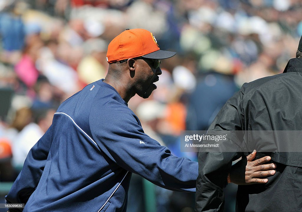 Manager Bo Porter of Houston Astros greets home plate umpire Jeff Gosney before play against the Detroit Tigers March 4, 2013 at Joker Marchant Stadium in Lakeland, Florida.