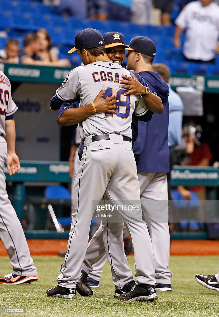 Manager Bo Porter #16 of the Houston Astros hugs starting pitcher Jarred Cosart #48 after a victory over the Tampa Bay Rays at Tropicana Field on July 12, 2013 in St. Petersburg, Florida.