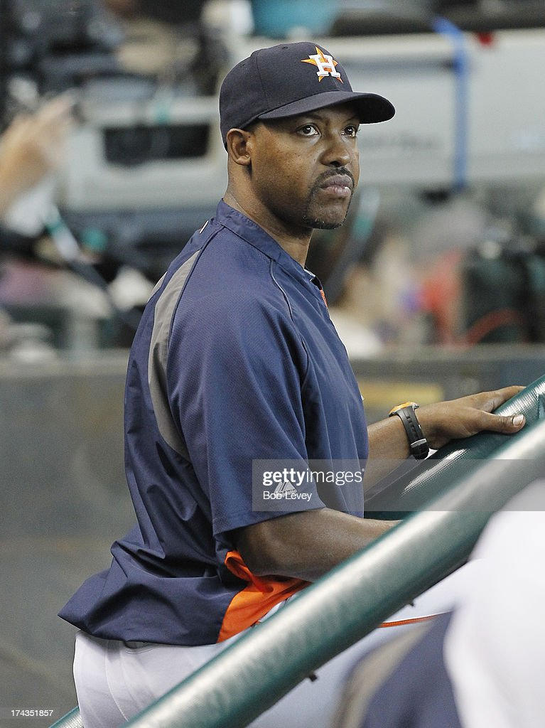 Manager Bo Porter #16 of the Houston Astros looks on from the dugout during a baseball game against the Oakland Athletics at Minute Maid Park on July 24, 2013 in Houston, Texas.