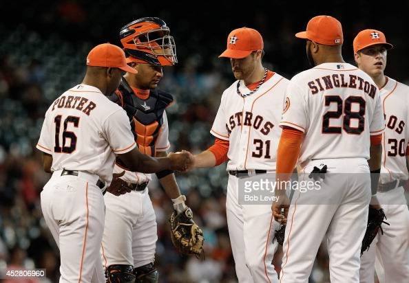 Manager Bo Porter of the Houston Astros takes Collin McHugh out of the game in the seventh inning as Jon Singleton Carlos Corporan and Matt Dominguez...