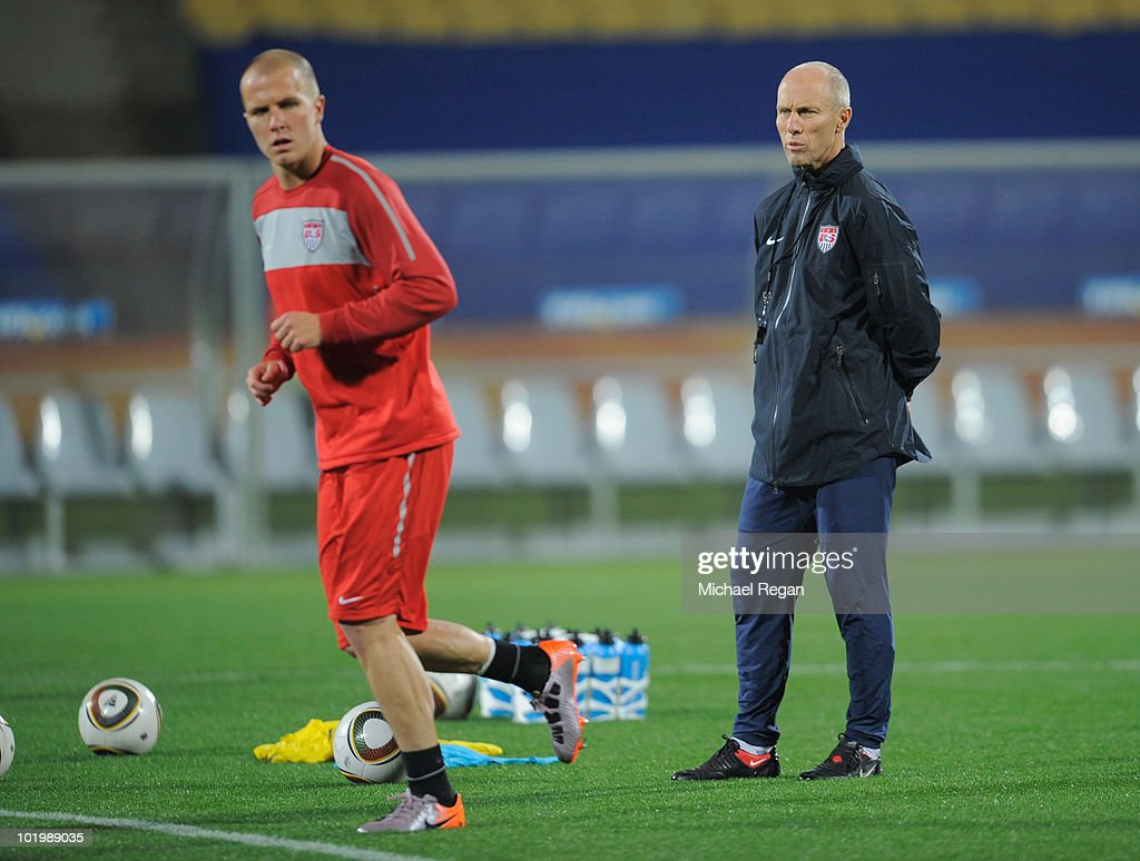 USA manager <a gi-track='captionPersonalityLinkClicked' href=/galleries/search?phrase=Bob+Bradley+-+Soccer+Manager&family=editorial&specificpeople=685515 ng-click='$event.stopPropagation()'>Bob Bradley</a> looks on as Michael Bradley trains during the USA training session at the Royal Bafokeng Stadium on June 11, 2010 in Rustenburg, South Africa.