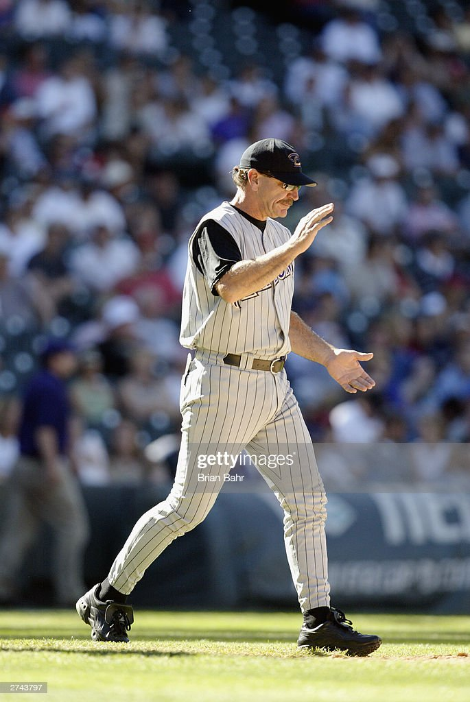 Manager Bob Brenly of the Arizona Diamondbacks walks out to the mound to make a pitching change against the Colorado Rockies September 25, 2003 at Coors Field in Denver, Colorado. The Diamondbacks won 8-7.
