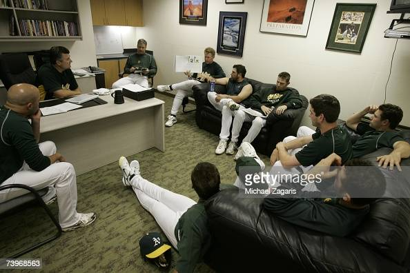 Manager Bob Geren and Curt Young of the Oakland Athletics conduct a pitchers' meeting in the clubhouse before the game against the Chicago White Sox...