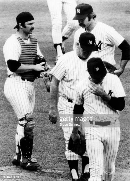 Manager Bob Lemon of the New York Yankees takes out pitcher Jim 'Catfish' Hunter and replaces him with Dick Tidrow as catcher Thurman Munson talks to...