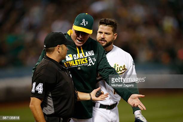 Manager Bob Melvin and Yonder Alonso of the Oakland Athletics are ejected by Umpire Mark Wegner after Alonso is called out on strike during the game...