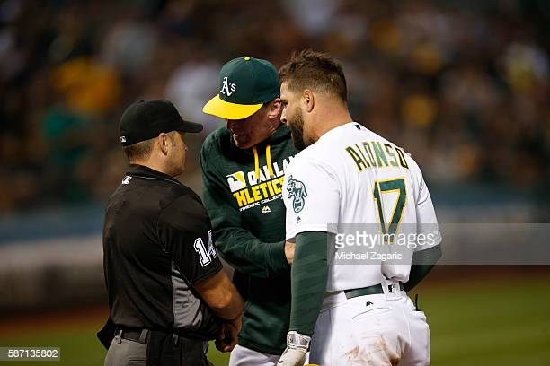 Manager Bob Melvin and Yonder Alonso of the Oakland Athletics argue with Umpire Mark Wegner after Alonso is called out on strike during the game...