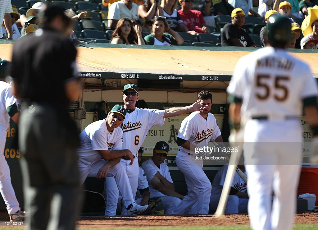 Manager <a gi-track='captionPersonalityLinkClicked' href=/galleries/search?phrase=Bob+Melvin&family=editorial&specificpeople=239192 ng-click='$event.stopPropagation()'>Bob Melvin</a> of the Oakland Athletics argues a stirke out by <a gi-track='captionPersonalityLinkClicked' href=/galleries/search?phrase=Hideki+Matsui&family=editorial&specificpeople=157483 ng-click='$event.stopPropagation()'>Hideki Matsui</a> #55 against the Texas Rangers at O.co Coliseum on August 14, 2011 in Oakland, California.