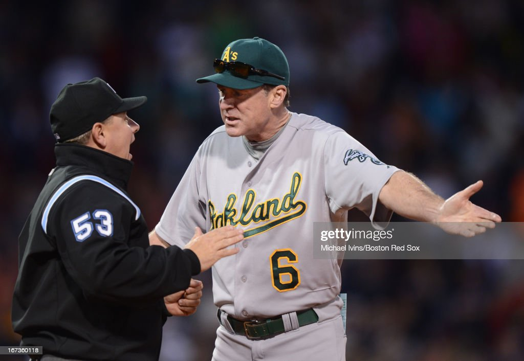 Manager Bob Melvin #6 of the Oakland Athletics argues with first base umpire Greg Gibson #53 after a foul ball call in favor of the Boston Red Sox in the ninth inning on April 24, 2013 at Fenway Park in Boston, Massachusetts.