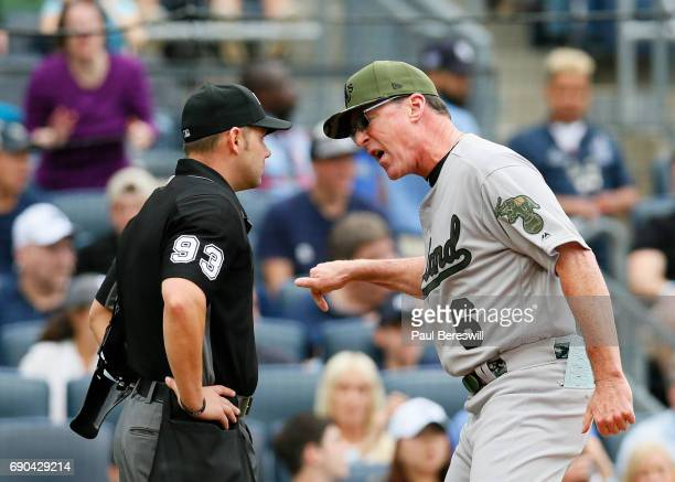 Manager Bob Melvin of the Oakland Athletics argues with home plate umpire Will Little after he is ejected from the game during the 8th inning of an...