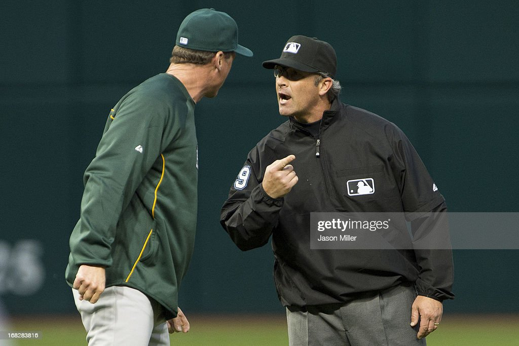 Manager <a gi-track='captionPersonalityLinkClicked' href=/galleries/search?phrase=Bob+Melvin&family=editorial&specificpeople=239192 ng-click='$event.stopPropagation()'>Bob Melvin</a> #6 of the Oakland Athletics argues with send base umpire umpire Paul Nauert #39 during the fifth inning against the Cleveland Indians at Progressive Field on May 7, 2013 in Cleveland, Ohio.