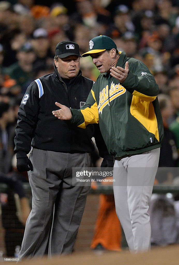 Manager <a gi-track='captionPersonalityLinkClicked' href=/galleries/search?phrase=Bob+Melvin&family=editorial&specificpeople=239192 ng-click='$event.stopPropagation()'>Bob Melvin</a> #6 of the Oakland Athletics argues with third base umpire Gerry Davis #12 over a ball hit down the line that Davis called fair for the San Francisco Giants in the six inning at AT&T Park on May 29, 2013 in San Francisco, California. Andres Torres #56 of the Giants hit the ball that went for an RBI double.