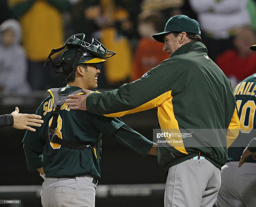 Manager <a gi-track='captionPersonalityLinkClicked' href=/galleries/search?phrase=Bob+Melvin&family=editorial&specificpeople=239192 ng-click='$event.stopPropagation()'>Bob Melvin</a> #6 of the Oakland Athletics celebrates his first win with the A's with <a gi-track='captionPersonalityLinkClicked' href=/galleries/search?phrase=Kurt+Suzuki&family=editorial&specificpeople=682702 ng-click='$event.stopPropagation()'>Kurt Suzuki</a> #8 after a four run 9th inning against the Chicago White Sox at U.S. Cellular Field on June 10, 2011 in Chicago, Illinois. The Athletics defeated the White Sox 7-5.