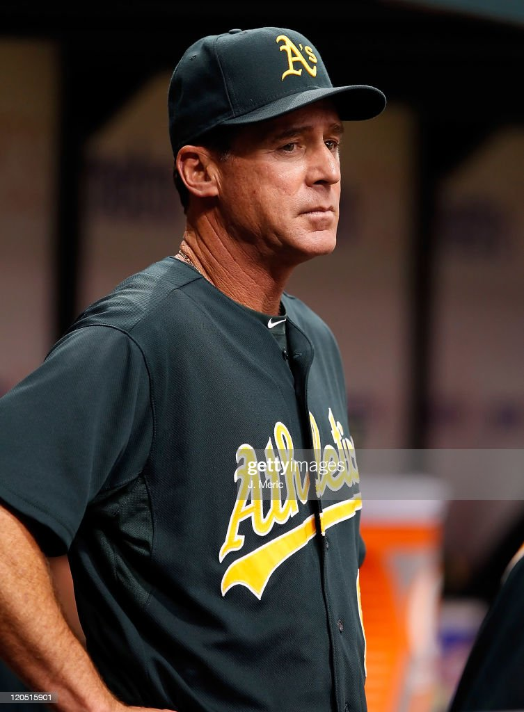 Manager <a gi-track='captionPersonalityLinkClicked' href=/galleries/search?phrase=Bob+Melvin&family=editorial&specificpeople=239192 ng-click='$event.stopPropagation()'>Bob Melvin</a> #6 of the Oakland Athletics directs his team against the Tampa Bay Rays during the game at Tropicana Field on August 6, 2011 in St. Petersburg, Florida.