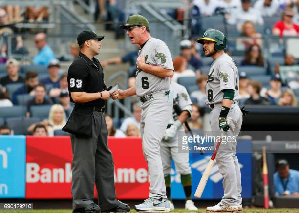 Manager Bob Melvin of the Oakland Athletics exchanges words with home plate umpire Will Little after Little ejected Jed Lowrie from the game during...