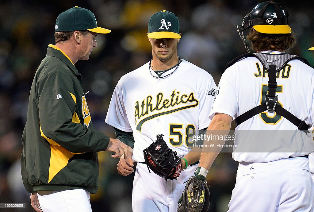 Manager <a gi-track='captionPersonalityLinkClicked' href=/galleries/search?phrase=Bob+Melvin&family=editorial&specificpeople=239192 ng-click='$event.stopPropagation()'>Bob Melvin</a> #6 of the Oakland Athletics gives the ball to pitcher Evan Scribner #58 after pitcher Ryan Cook #48 (not pictured) walked in a run with the bases loaded against the Seattle Mariners in the seventh inning at O.co Coliseum on April 2, 2013 in Oakland, California.