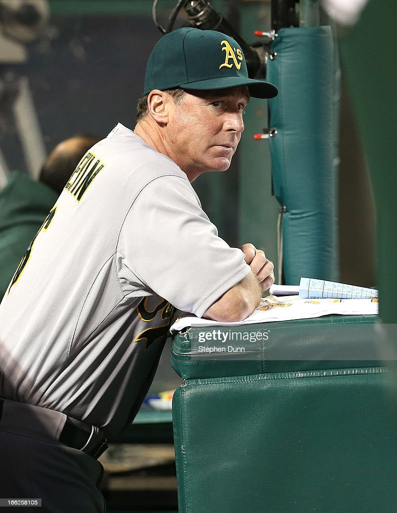 Manager Bob Melvin of the Oakland Athletics looks on from the dugout during the game against the Los Angeles Angels of Anaheim at Angel Stadium of Anaheim on April 10, 2013 in Anaheim, California.