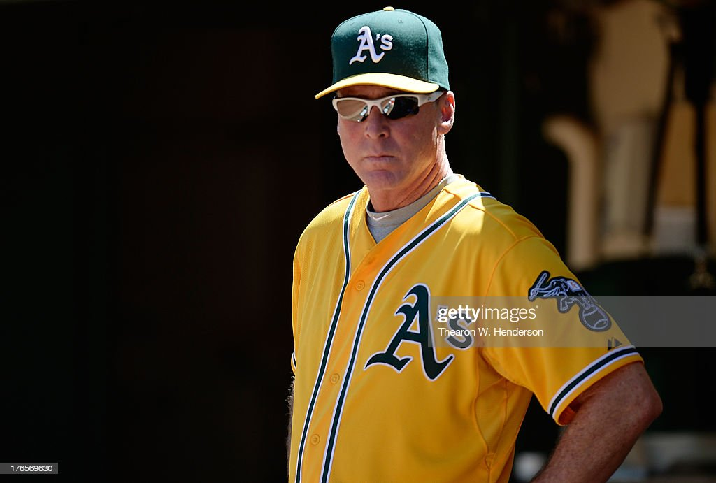 Manager <a gi-track='captionPersonalityLinkClicked' href=/galleries/search?phrase=Bob+Melvin&family=editorial&specificpeople=239192 ng-click='$event.stopPropagation()'>Bob Melvin</a> #6 of the Oakland Athletics looks on from the dugout in the fifth inning against the Houston Astros at O.co Coliseum on August 15, 2013 in Oakland, California.